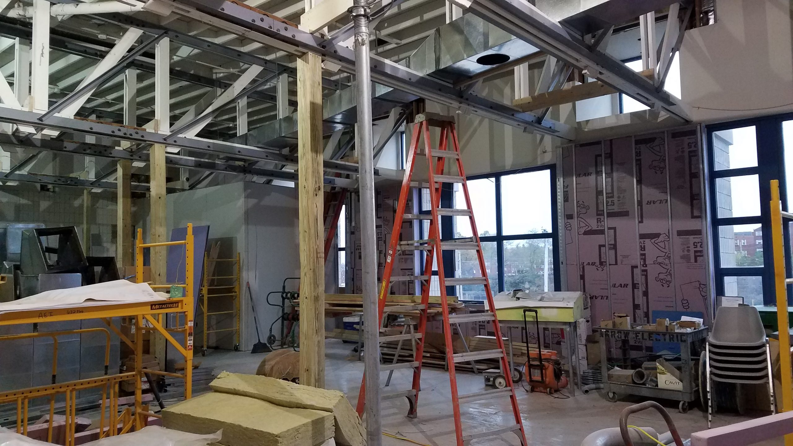 Organized chaos–new steel roof beams going in.